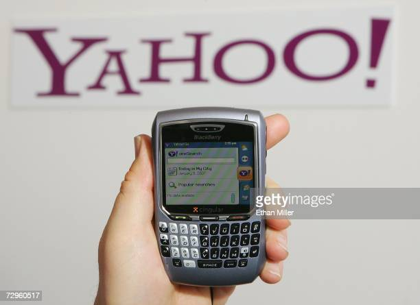 Alex Laity of Yahoo Inc holds a Blackberry 8700 displaying Yahoo's OneSearch mobile search home page which is part of the company's newlylaunched Go...