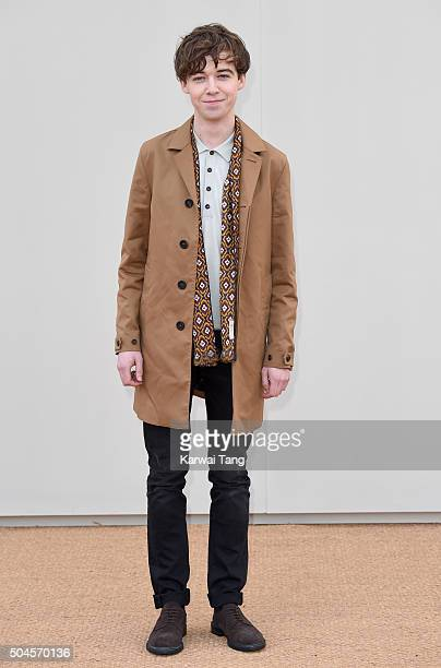 Alex Lawther attends the Burberry show during The London Collections Men AW16 at Kensington Gardens on January 11 2016 in London England