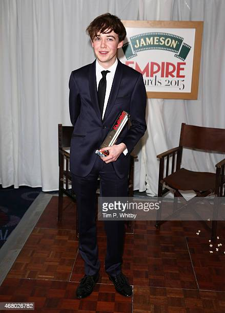 Alex Lawther collects the Best Thriller Award for The Imitation Game during the Jameson Empire Awards 2015 at the Grosvenor House Hotel on March 29...