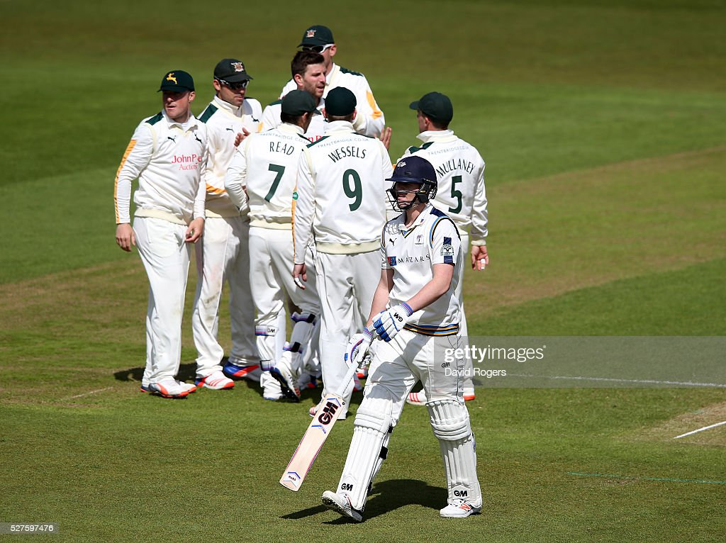 Alex Lees of Yorkshire walks off the pitch after being caught behind off the bowling of Harry Gurney for 92 runs during the Specsavers County Championship division one match between Nottinghamshire and Yorkshire at the Trent Bridge on May 3, 2016 in Nottingham, England.