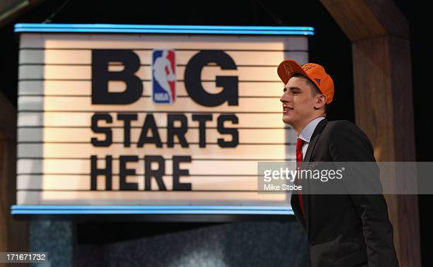 Alex Len of Maryland walks on stage after Len was drafted overall in the first round by the Phoenix Suns during the 2013 NBA Draft at Barclays Center...