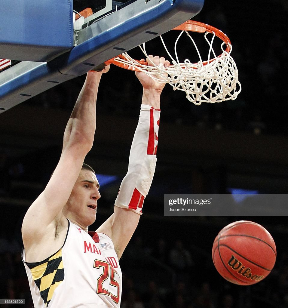 Alex Len #25 of the Maryland Terapins dunks the ball past the Iowa Hawkeyes defense in the first half during the 2013 NIT Championship - Semifinals at the Madison Square Garden on April 2, 2013 in New York City.