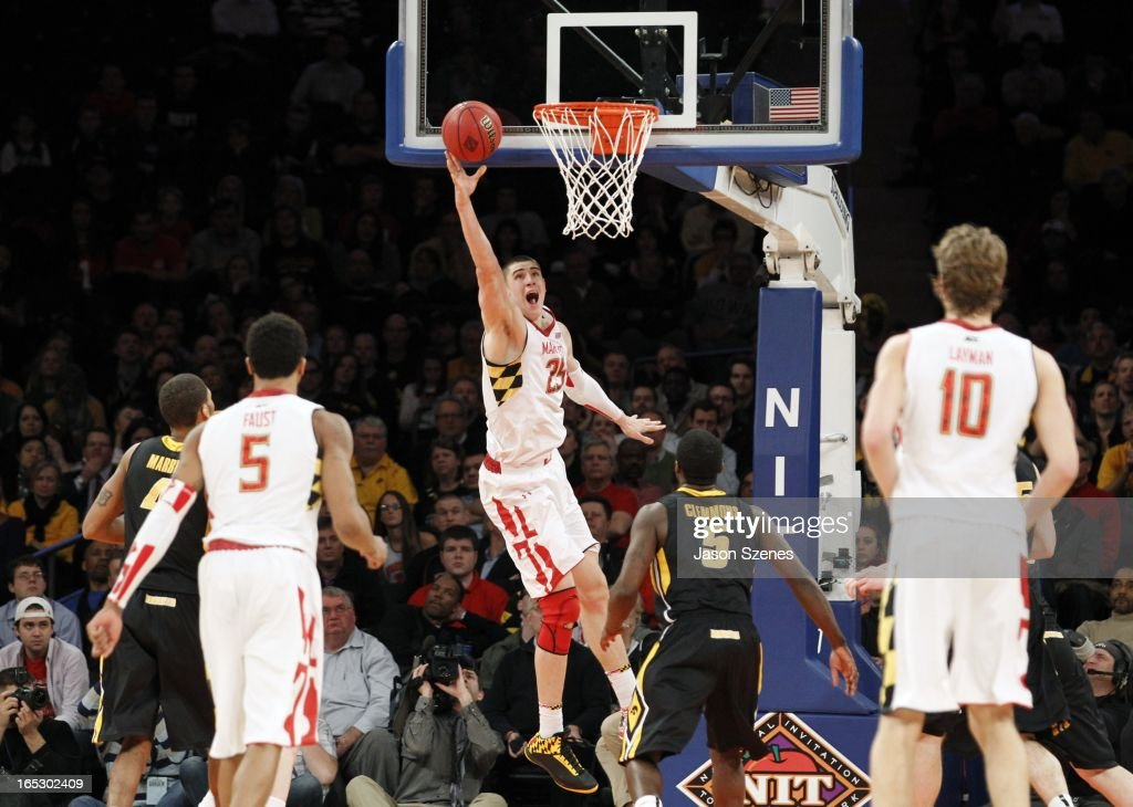 Alex Len #25 of the Maryland Terapins puts up a basket past Anthony Clemmons #5 of the Iowa Hawkeyes defense in the second half during the 2013 NIT Championship - Semifinals at the Madison Square Garden on April 2, 2013 in New York City.