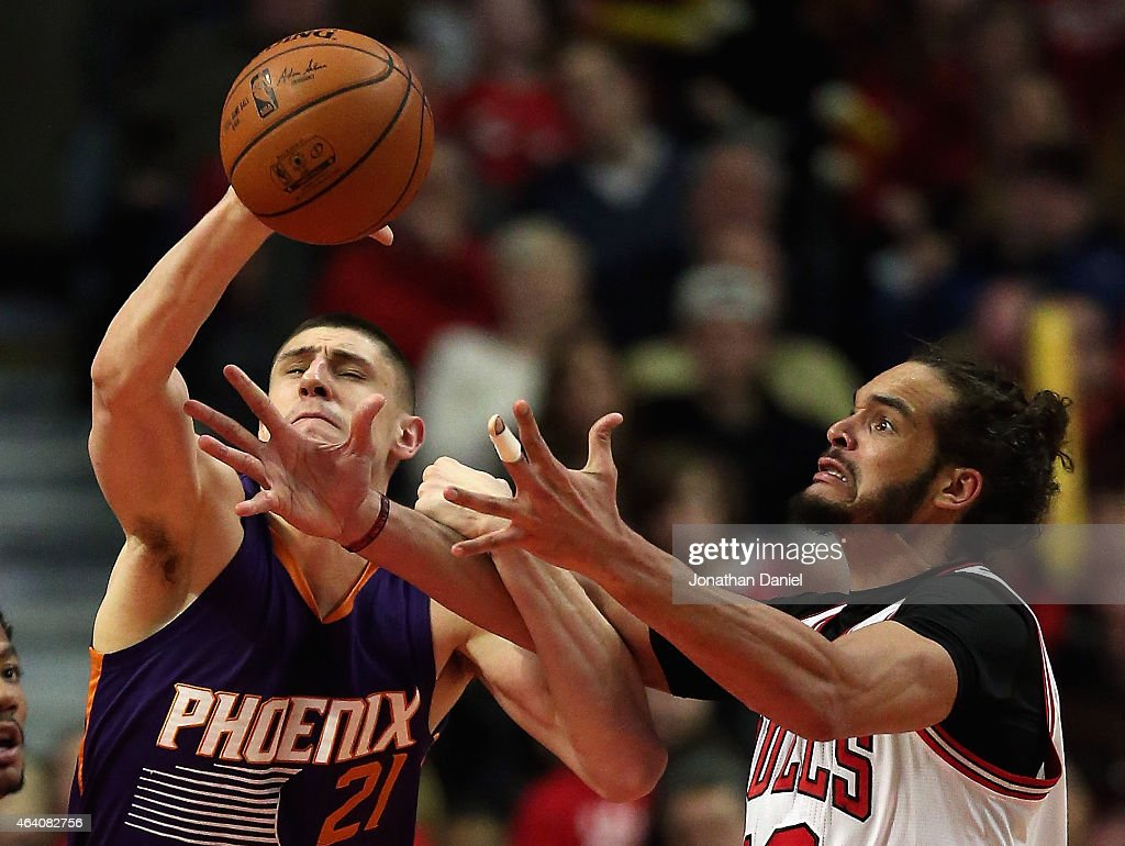 Alex Len #21 of the Phoenix Suns and Joakim Noah #13 of the Chicago Bulls battle for a rebound at the United Center on February 21, 2015 in Chicago, Illinois. The Bulls defeated the Suns 112-107.