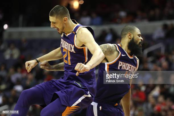 Alex Len of the Phoenix Suns and Tyson Chandler celebrate against the Washington Wizards during the second half at Capital One Arena on November 01...