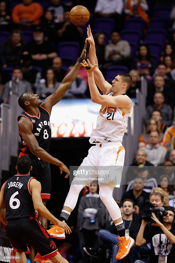 Alex Len #21 of the Phoenix Suns attempts a shot over Bismack Biyombo #8 of the Toronto Raptors during the first half of the NBA game at Talking Stick Resort Arena on February 2, 2016 in Phoenix, Arizona.