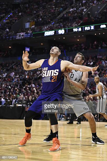 Alex Len of the Phoenix Suns bpxes out David Lee of the San Antonio Spurs as part of NBA Global Games at Arena Ciudad de Mexico on January 14 2017 in...