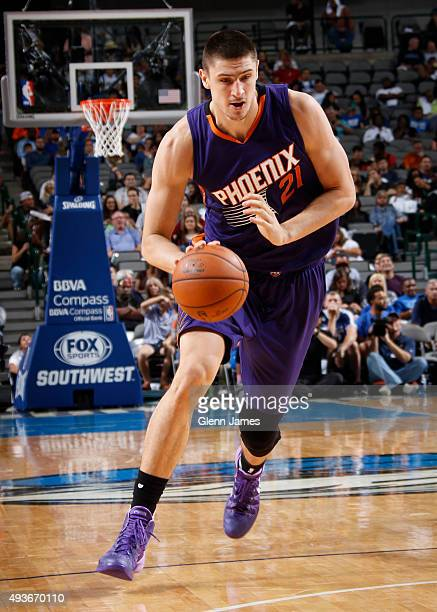 Alex Len of the Phoenix Suns drives against the Dallas Mavericks on October 21 2015 at the American Airlines Center in Dallas Texas NOTE TO USER User...