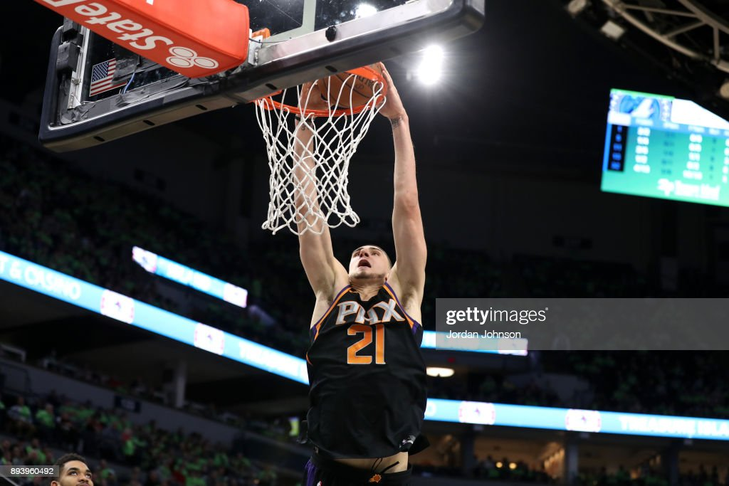Alex Len #21 of the Phoenix Suns dunks against the Minnesota Timberwolves on December 16, 2017 at Target Center in Minneapolis, Minnesota.