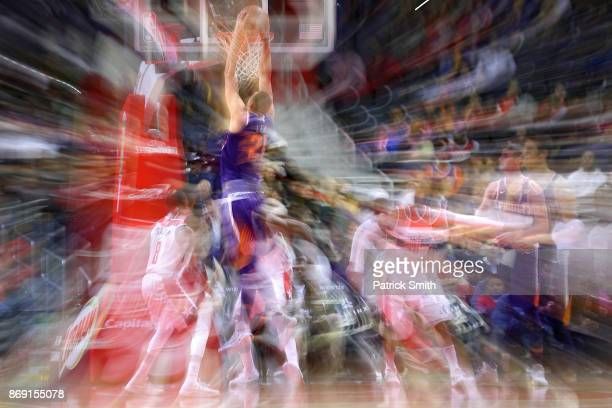 Alex Len of the Phoenix Suns dunks in front of Tim Frazier of the Washington Wizards during the first half at Capital One Arena on November 01 2017...