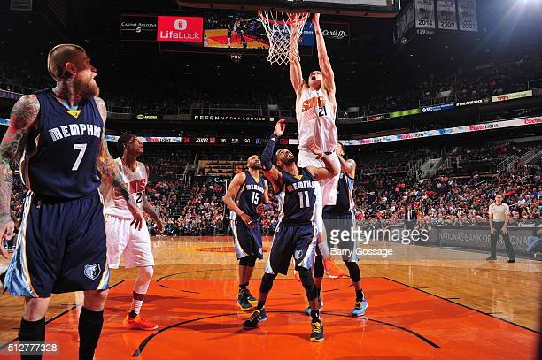 Alex Len of the Phoenix Suns goes to the basket against the Memphis Grizzlies on February 27 2016 at Talking Stick Resort Arena in Phoenix Arizona...