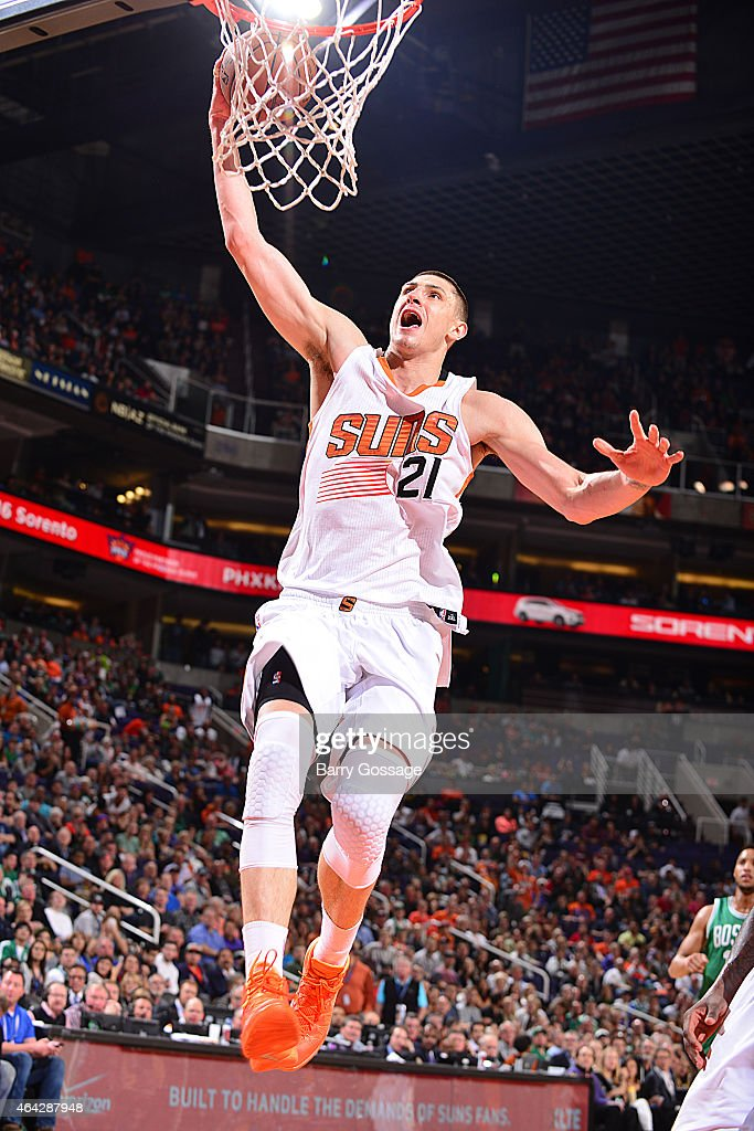Alex Len #21 of the Phoenix Suns goes up for a dunk against the Boston Celtics on February 23, 2015 at U.S. Airways Center in Phoenix, Arizona.