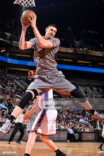 Alex Len of the Phoenix Suns grabs a rebound against the Oklahoma City Thunder on February 26 2015 at US Airways Center in Phoenix Arizona NOTE TO...