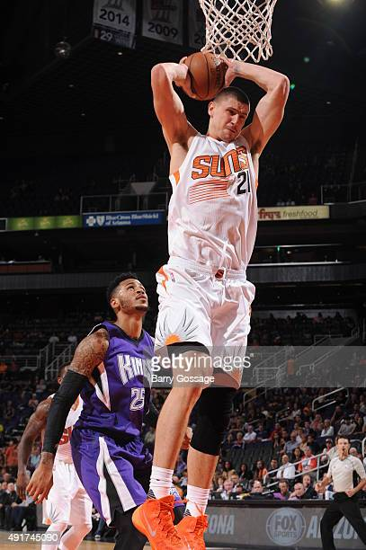 Alex Len of the Phoenix Suns grabs a rebound against the Sacramento Kings on October 7 2015 at Talking Stick Resort Arena in Phoenix Arizona NOTE TO...