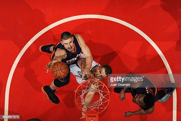 Alex Len of the Phoenix Suns grabs a rebound over Austin Rivers of the LA Clippers on October 31 2016 at the STAPLES Center in Los Angeles California...