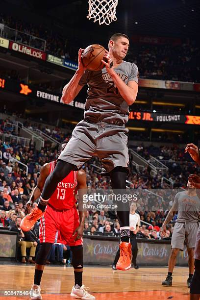 Alex Len of the Phoenix Suns grabs the rebound against the Houston Rockets on February 4 2016 at Talking Stick Resort Arena in Phoenix Arizona NOTE...