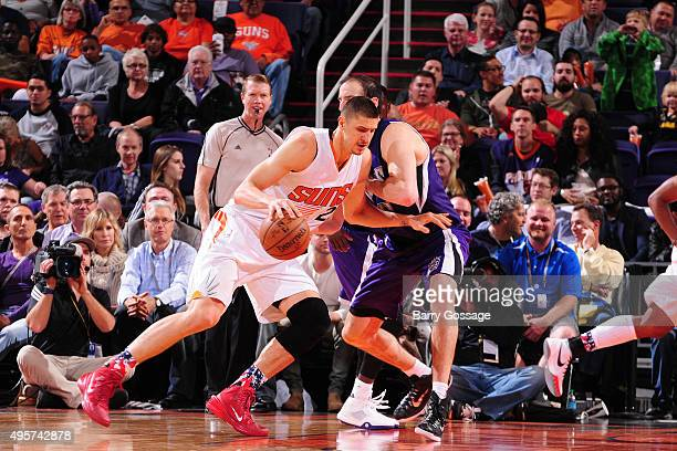 Alex Len of the Phoenix Suns handles the ball against the Sacramento Kings during the game on November 4 at Talking Stick Resort Arena in Phoenix...