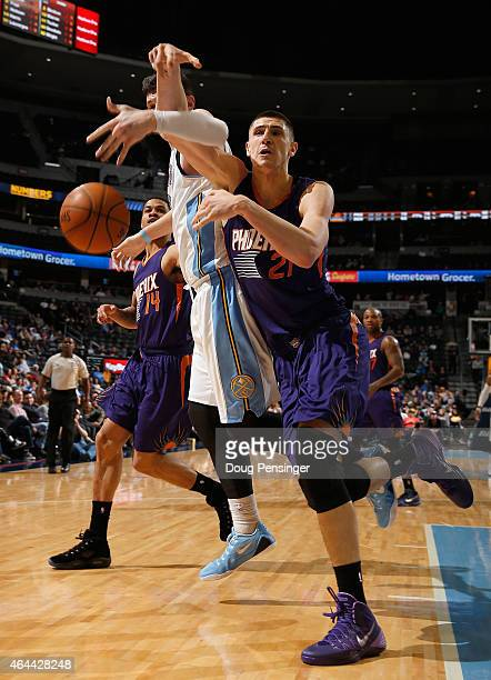 Alex Len of the Phoenix Suns is fouled by Jusuf Nurkic of the Denver Nuggets as they pursue a loose ball at Pepsi Center on February 25 2015 in...