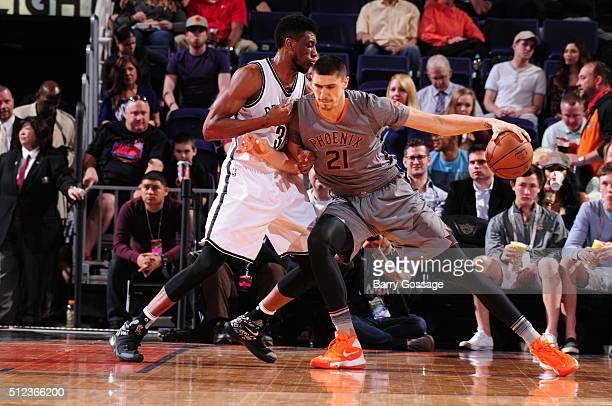 Alex Len of the Phoenix Suns is guarded by Thaddeus Young of the Brooklyn Nets on February 25 at Talking Stick Resort Arena in Phoenix Arizona NOTE...
