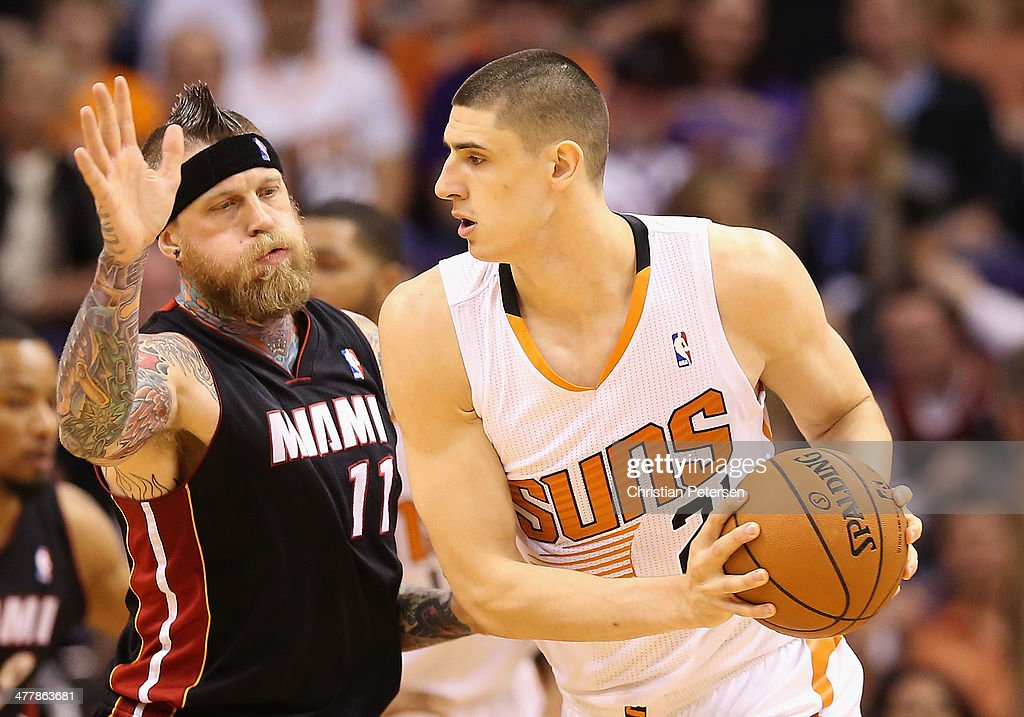 Alex Len #21 of the Phoenix Suns looks to pass against Chris Andersen #11 of the Miami Heat during the NBA game at US Airways Center on February 11, 2014 in Phoenix, Arizona. The Heat defeated the Suns 103-97.