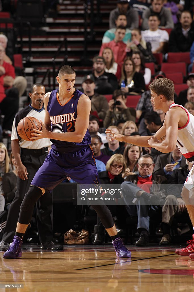Alex Len #21 of the Phoenix Suns looks to pass the ball against the Portland Trail Blazers on October 9, 2013 at the Moda Center Arena in Portland, Oregon.