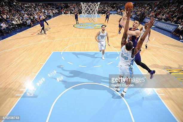 Alex Len of the Phoenix Suns shoots against the Denver Nuggets on February 18 2014 at the Pepsi Center in Denver Colorado NOTE TO USER User expressly...