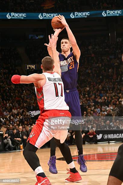 Alex Len of the Phoenix Suns shoots against the Toronto Raptors on November 24 2014 at the Air Canada Centre in Toronto Ontario Canada NOTE TO USER...