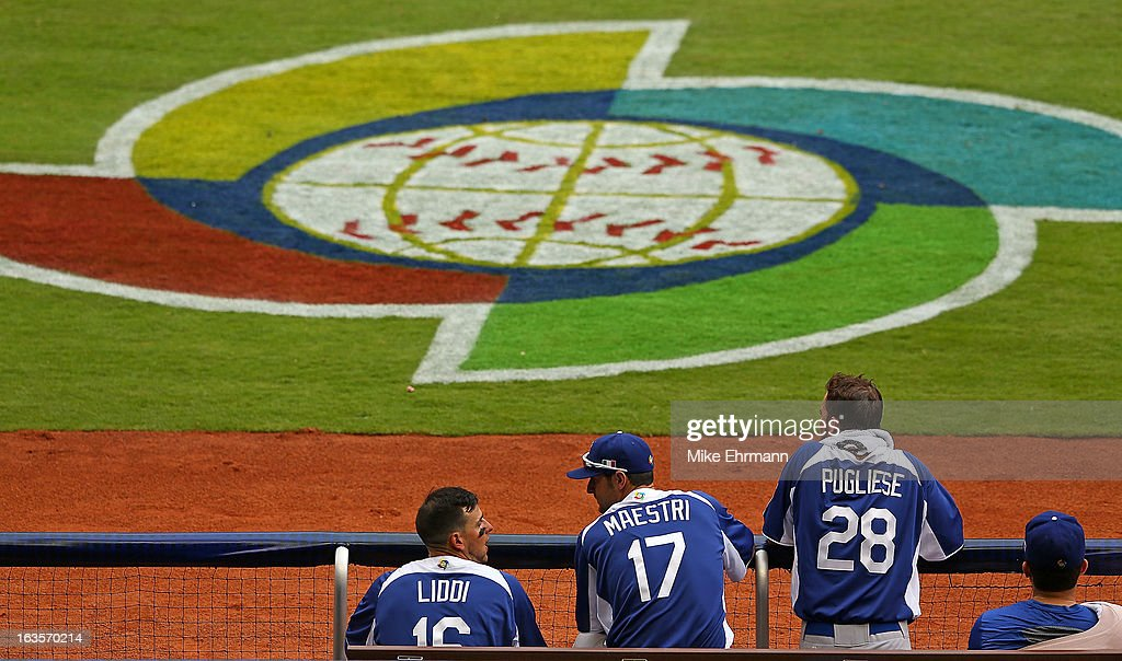 Alex Liddi and Alex Maestri talk during a World Baseball Classic second round game against the Dominican Republic at Marlins Park on March 12 2013 in...