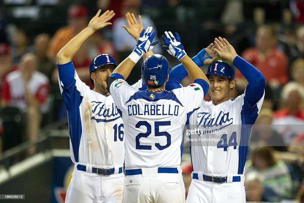 Alex Liddi #16 and Anthony Rizzo #44 of Italy celebrate a home run hit by Chris Colabello #25 of Italy against Canada during the World Baseball Classic First Round Group D game on March 8, 2013 at Chase Field in Phoenix, Arizona.