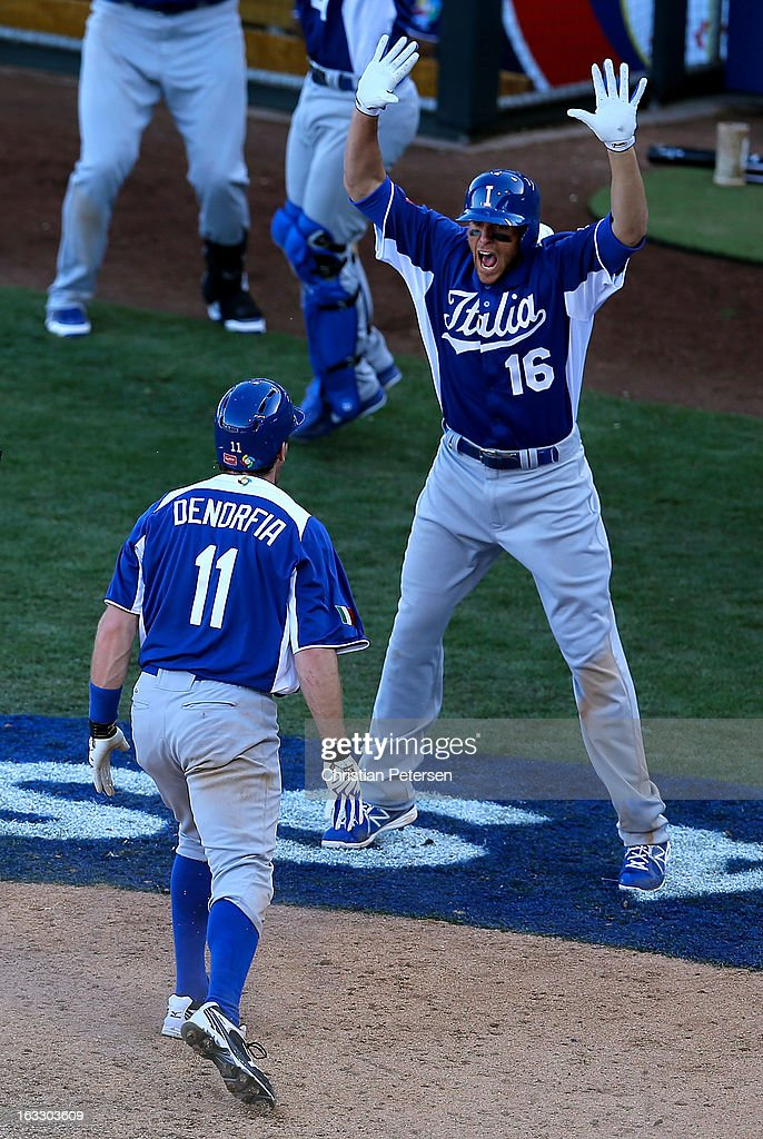 Alex Liddi #16 of Italy celebrates with Chris Denorfia #11 after Denorfia scored the go ahead run against Mexico during the ninth inning of the World Baseball Classic First Round Group D game at Salt River Fields at Talking Stick on March 7, 2013 in Scottsdale, Arizona. Italy defeated Mexico 6-5.