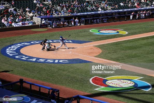 Alex Liddi of Italy hits a single against Mexico during the fifth inning of the World Baseball Classic First Round Group D game at Salt River Fields...