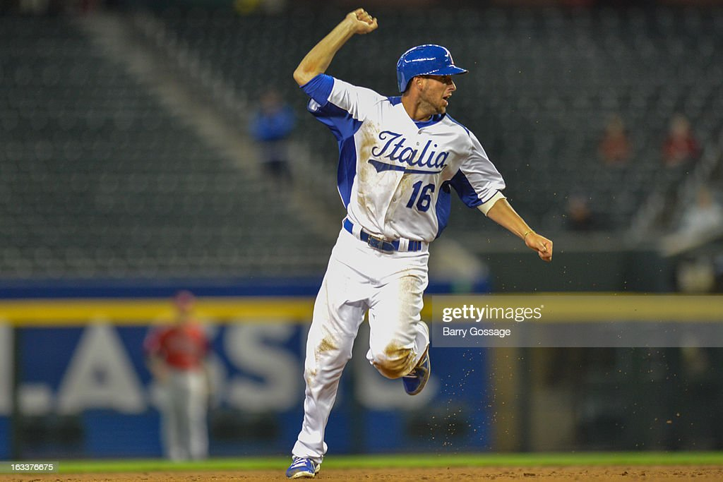 Alex Liddi #16 of Team Italy celebrates as he rounds the bases to score on Chris Colabello's three-run home run in the bottom of the third inning of Pool D, Game 2 against Team Canada at Chase Field on Friday, March 8, 2013 in Phoenix, Arizona.
