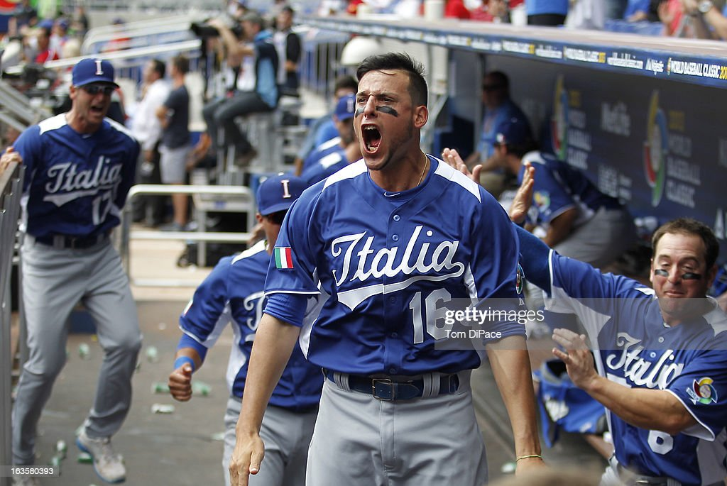 Alex Liddi of Team Italy celebrates in the dugout after Chris Colabello hits a threerun home run in the top of the first inning of Pool 2 Game 1...