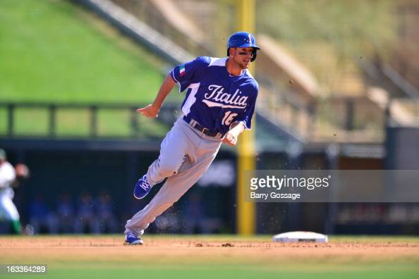 Alex Liddi of Team Italy rounds second base during Pool D Game 1 between Italy and Mexico in the first round of the 2013 World Baseball Classic at...