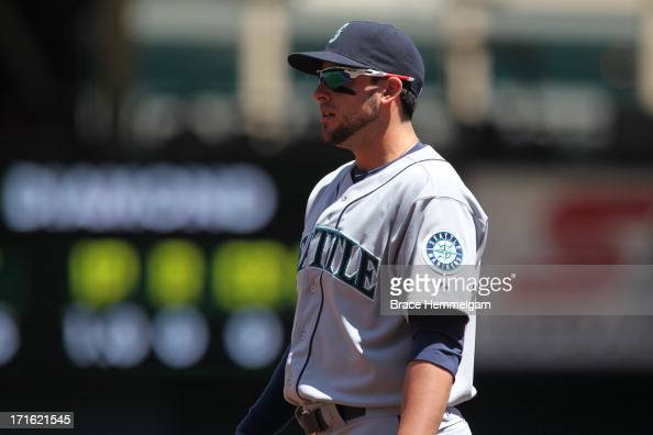 Alex Liddi of the Seattle Mariners looks on against the Minnesota Twins on June 2 2013 at Target Field in Minneapolis Minnesota The Twins defeated...