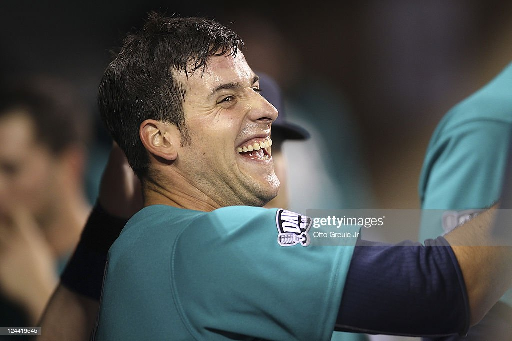 <a gi-track='captionPersonalityLinkClicked' href=/galleries/search?phrase=Alex+Liddi&family=editorial&specificpeople=5751736 ng-click='$event.stopPropagation()'>Alex Liddi</a> #16 of the Seattle Mariners smiles in the dugout after scoring on an RBI single against the Kansas City Royals at Safeco Field on September 9, 2011 in Seattle, Washington.
