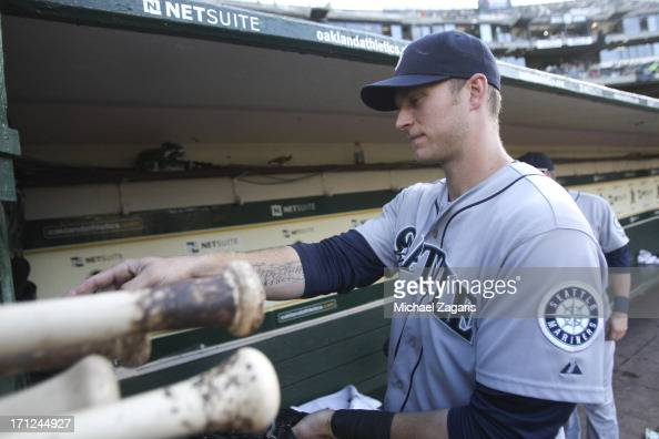 Alex Liddi of the Seattle Mariners stands in the dugout prior to the game against the Oakland Athletics at Oco Coliseum on June 14 2013 in Oakland...
