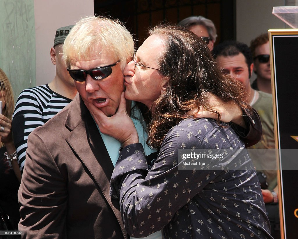 Alex Lifeson and Geddy Lee attend the Hollywood Walk Of Fame star ceremony honoring their band RUSH held on June 25 2010 in Hollywood California