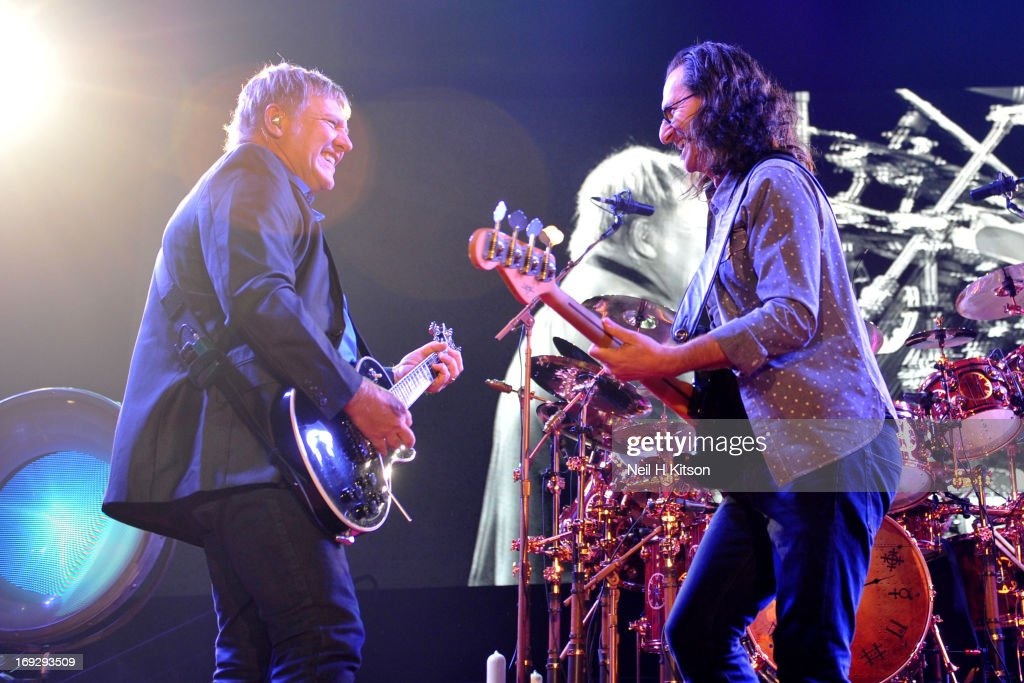 Alex Lifeson and Geddy Lee of Rush perform on stage at Manchester Arena on May 22, 2013 in Manchester, England.