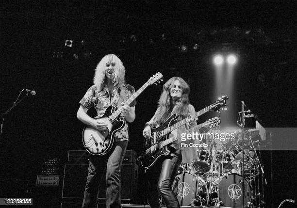 Alex Lifeson Canadian guitarist playing a guitar and Geddy Lee Canadian bassist and guitarist playing a doublenecked guitar on stage during a live...
