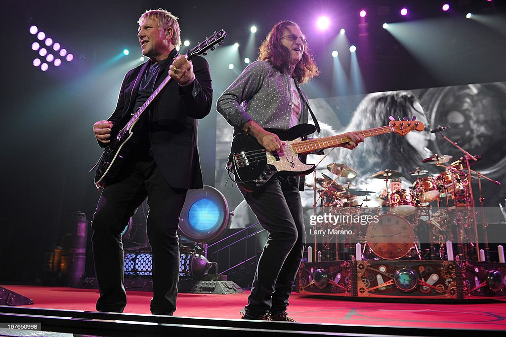 Alex Lifeson, Geddy Lee and Neil Peart of Rush perform at BB&T Center on April 26, 2013 in Sunrise, Florida.