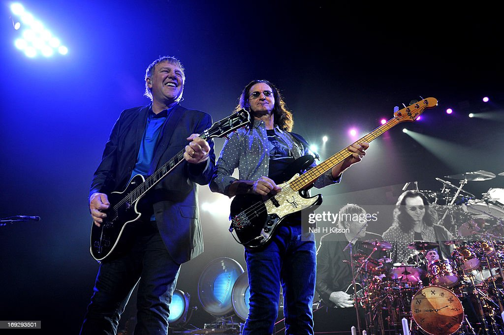 <a gi-track='captionPersonalityLinkClicked' href=/galleries/search?phrase=Alex+Lifeson&family=editorial&specificpeople=228149 ng-click='$event.stopPropagation()'>Alex Lifeson</a>, <a gi-track='captionPersonalityLinkClicked' href=/galleries/search?phrase=Geddy+Lee&family=editorial&specificpeople=212809 ng-click='$event.stopPropagation()'>Geddy Lee</a> and <a gi-track='captionPersonalityLinkClicked' href=/galleries/search?phrase=Neil+Peart&family=editorial&specificpeople=2133163 ng-click='$event.stopPropagation()'>Neil Peart</a> of Rush perform on stage at Manchester Arena on May 22, 2013 in Manchester, England.