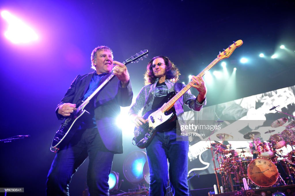 Alex Lifeson, Geddy Lee and Neil Peart of Rush perform on stage at Manchester Arena on May 22, 2013 in Manchester, England.