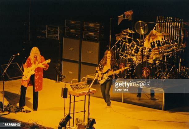 Alex Lifeson Geddy Lee and Neil Peart of Rush perform on stage at Hammersmith Odeon on February 20th 1978 in London England