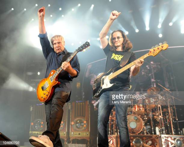 Alex Lifeson Geddy Lee and Neil Peart of Rush perform on the final night of their north American tour at Cruzan Amphitheatre on October 2 2010 in...