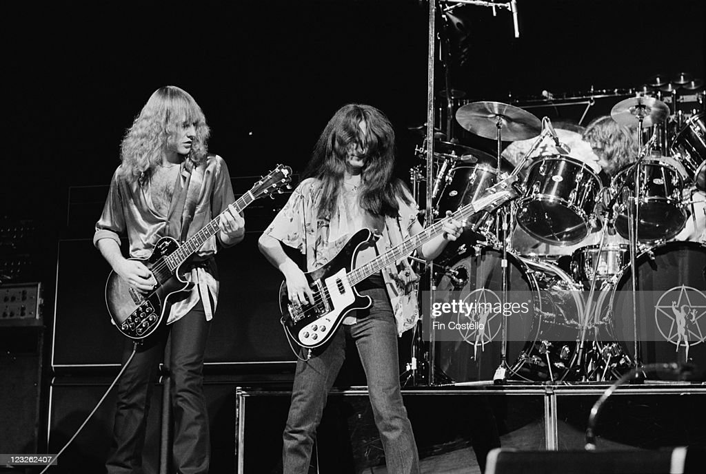 Alex Lifeson guitarist and Geddy Lee singer and bassist with Canadian rock band Rush on stage during a live concert performance by the band at the...