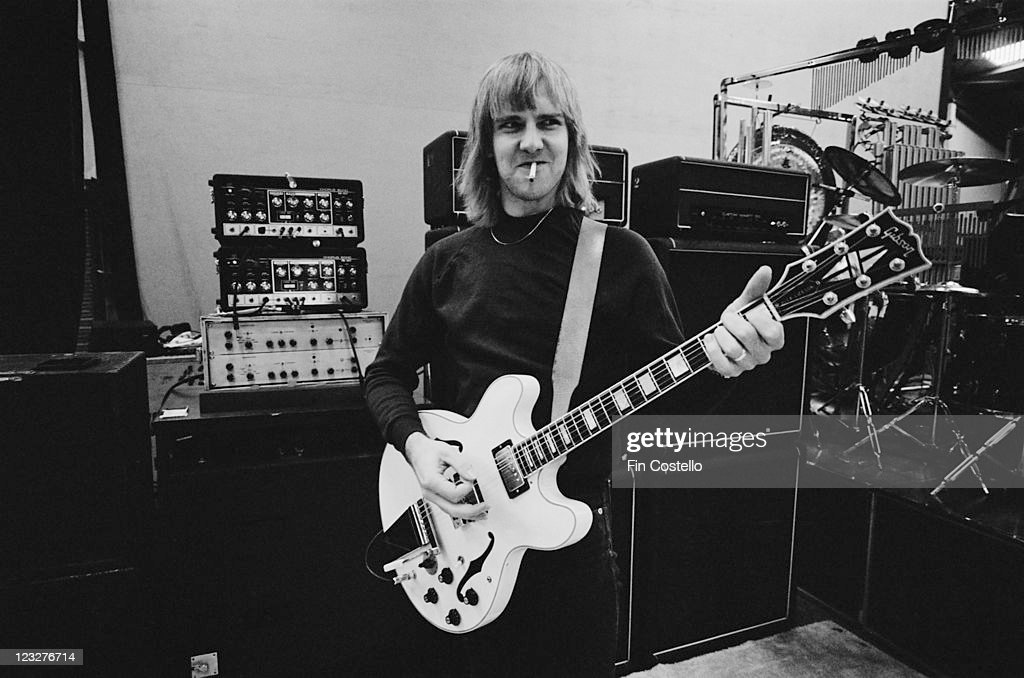 Alex Lifeson guitarist with Canadian rock band Rush smoking a cigarette as he plays his guitar during a soundcheck ahead of the band's gig at Bingley...