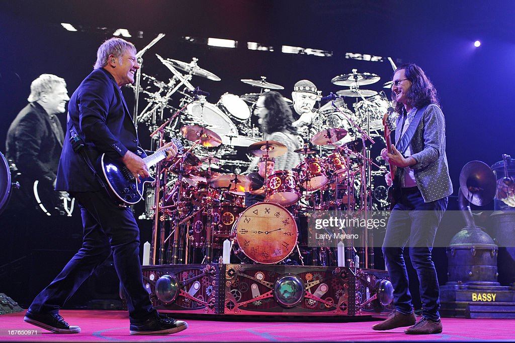 Alex Lifeson, Neil Peart and Geddy Lee of Rush perform at BB&T Center on April 26, 2013 in Sunrise, Florida.