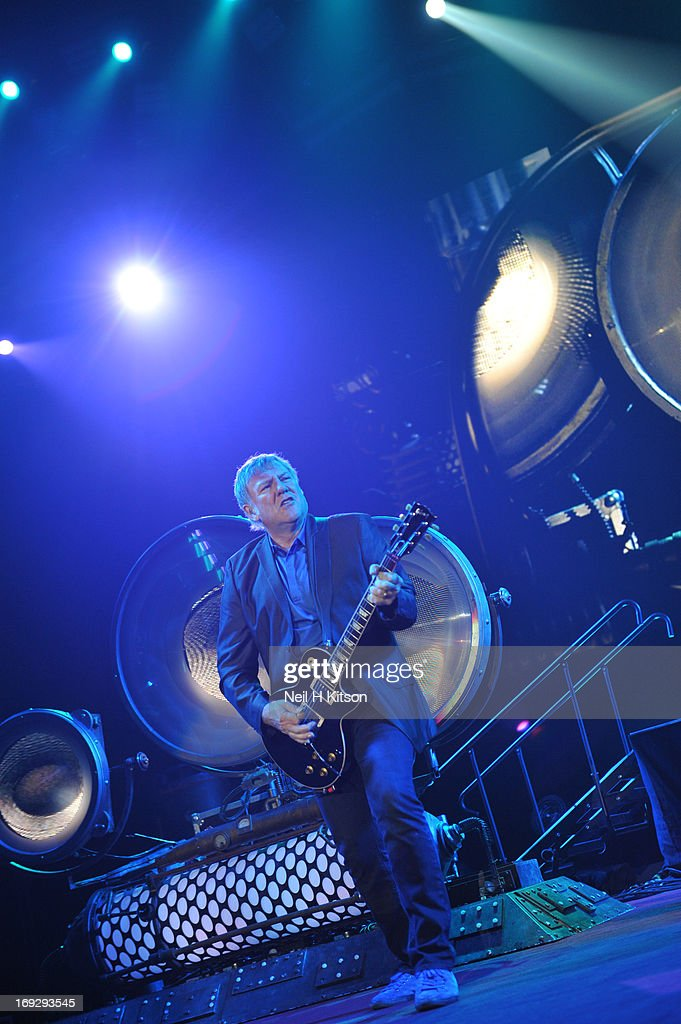 Alex Lifeson of Rush performs on stage at Manchester Arena on May 22, 2013 in Manchester, England.