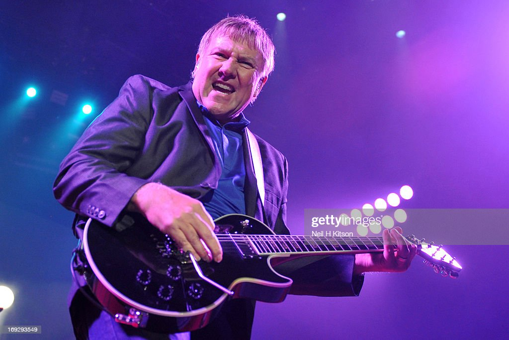 <a gi-track='captionPersonalityLinkClicked' href=/galleries/search?phrase=Alex+Lifeson&family=editorial&specificpeople=228149 ng-click='$event.stopPropagation()'>Alex Lifeson</a> of Rush performs on stage at Manchester Arena on May 22, 2013 in Manchester, England.